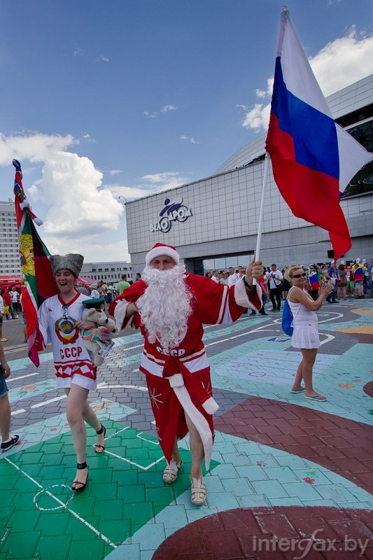 Russian ice hockey fans are waiving flags at Minsk-Arena