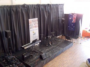 Australian flag decorating music stage at Dom Talanta. Photo by Ben M. Angel
