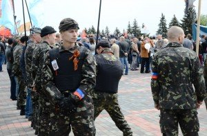 Pro-Russian militants form up for the Donetsk Victory Day parade in May. Their continued existence in the face of Ukraine's Counter-Terror Operation has been ascribed to Russian support in both men and arms. Photo by Andrew Butko via Wikimedia Commons