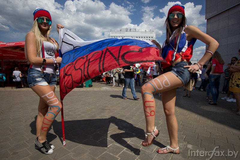 Russian girls are posing with Russian flag