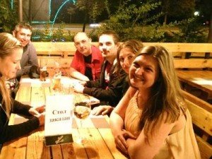 Gabriella Temel, far right, sits at the table with members of the Minsk Internations community at their August event, held at the Three Musketeers Pub off Kastrychnitskaya Street near Concert Hall Minsk. Photo via Gabriella Furusjo Temel