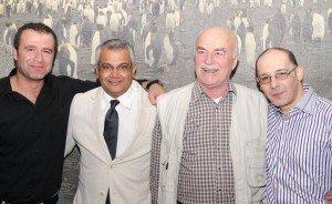 Puneet Shrivastava (second from left), co-ambassador, posing in front of penguin mural with Taner Temel (husband of senior co-ambassador Gabriella, left), Tom van Kemenade, and Nick Balidakis (both to the right). Photo by Gabriella Temel